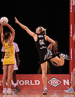 23.09.2012 Silver Ferns Katrina Grant and Australian Natalie Medhurst in action during the third netball test match between the Silver Ferns and the Australian Diamonds at CBS Canterbury Arena in Christchurch. Mandatory Photo Credit ©Michael Bradley.