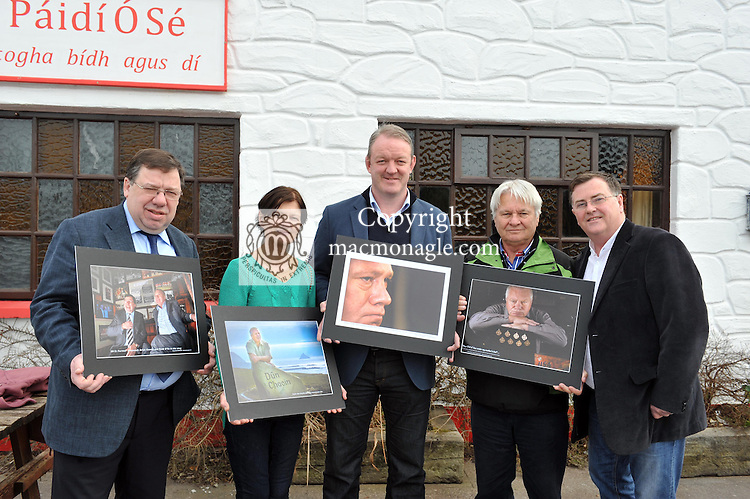 """24-2-2013: Former Taoiseach Brian Cowen, Maire O""""Se,  former rugby International Mick Galwey, Tomas O""""Se and photographer Don MacMonagle pictured at the opening of an exhibition of photographs of the late Paidi O'Se at the Comortas Peile in Paidi's pub in Ventry County Kerry on Sunday. Fifty photographs of Paidi taken by Don MacMonagle, over a quarter of a century, are now on permanent display in the pub and feature Paidi playing in his football years, his involvement with politics and appearances at social gatherings..Picture by Mary Susan MacMonagle FREE PHOTO FROM MACMONAGLE PHOTOGRAPHY"""