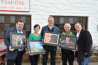 "24-2-2013: Former Taoiseach Brian Cowen, Maire O""Se,  former rugby International Mick Galwey, Tomas O""Se and photographer Don MacMonagle pictured at the opening of an exhibition of photographs of the late Paidi O'Se at the Comortas Peile in Paidi's pub in Ventry County Kerry on Sunday. Fifty photographs of Paidi taken by Don MacMonagle, over a quarter of a century, are now on permanent display in the pub and feature Paidi playing in his football years, his involvement with politics and appearances at social gatherings..Picture by Mary Susan MacMonagle FREE PHOTO FROM MACMONAGLE PHOTOGRAPHY"