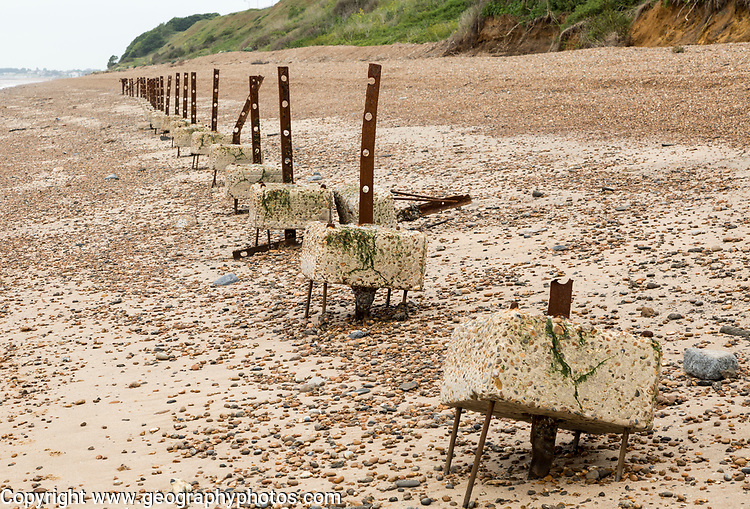 Remains of steel stanchions for barbed wire anti-invasion defences on beach at Bawdsey, Suffolk, England, UK