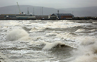 WEATHER PICTURE SWANSEA<br /> Pictured: Swansea docks hit by rough seas, south Wales. Monday 03 February 2014<br /> Re: High tides combined with strong winds are affecting parts of the UK.