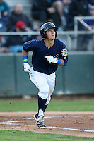 Austin Cousino #19 of the Everett AquaSox runs to first base during a game against the Boise Hawks at Everett Memorial Stadium on July 25, 2014 in Everett, Washington. Everett defeated Boise, 2-1. (Larry Goren/Four Seam Images)