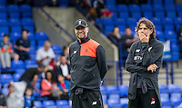 Liverpool Manager Jurgen Klopp smiles as Assistant Coach Zeljko Buvac covers his face during the 2016/17 Pre Season Friendly match between Tranmere Rovers and Liverpool at Prenton Park, Birkenhead, England on 8 July 2016. Photo by PRiME Media Images.
