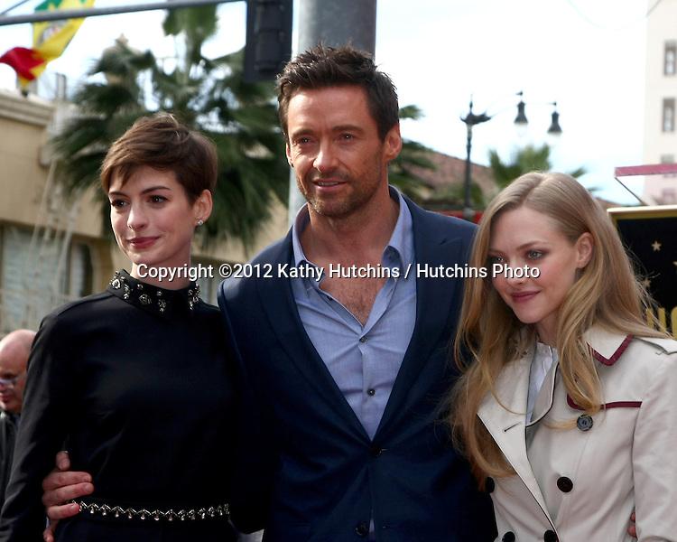 LOS ANGELES - DEC 13:  Anne Hathaway, Hugh Jackman, Amanda Seyfried at the Hollywood Walk of Fame ceremony for Hugh Jackman at Hollywood Boulevard on December 13, 2012 in Los Angeles, CA
