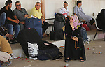 Palestinians wait for travel permits to cross into Egypt through the Rafah border crossing after it was opened by Egyptian authorities for humanitarian cases, in Rafah in the southern Gaza Strip on Gaza Strip August 17, 2017. Photo by Ashraf Amra
