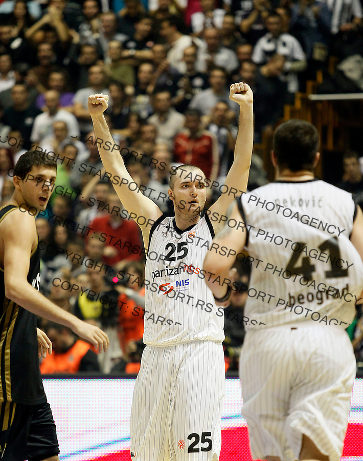 Kosarka, Euroleague, sezona 2011/2012.Partizan Vs. Real Madrid.Milan Macvan, center, Nikola Mirotic, left and Nikola Pekovic, right.Belgrade, 10.11.2011..foto: Srdjan Stevanovic/Starsportphoto ©