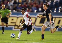 HOOVER, AL - DECEMBER 07, 2012:  Christiano Francois (3) of the University of Maryland races away from Joey Dillon (4) of Georgetown University during an NCAA 2012 Men's College Cup semi-final match, at Regents Park, in Hoover , AL, on Friday, December 07, 2012. The game ended in a 4-4 tie, after overtime Georgetown won on penalty kicks.