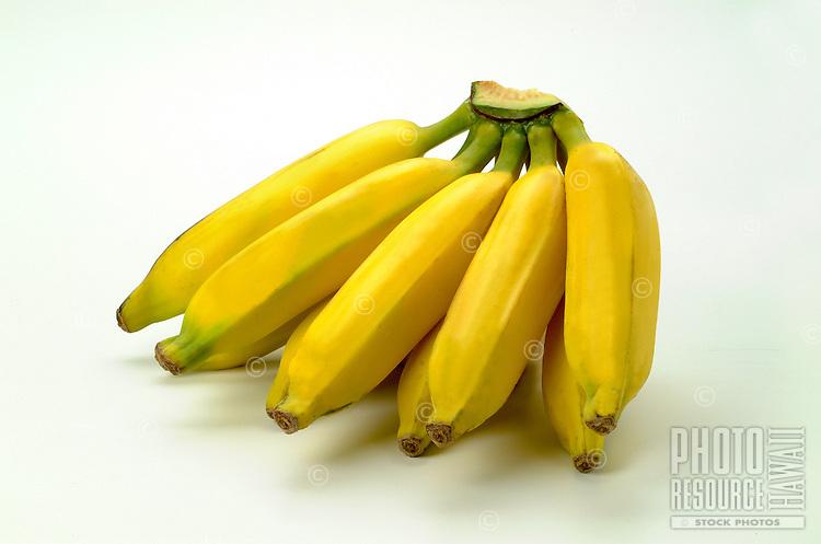 Studio photo of yellow apple bananas on white background.
