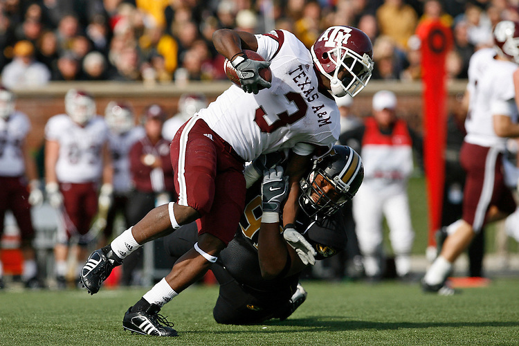 MU tackle Charles Gaines (91) tackles Texas A&M tailback Mike Goodson during the first half at Memorial Stadium in Columbia, Missouri on November 10, 2007. The Tigers won 40-26.