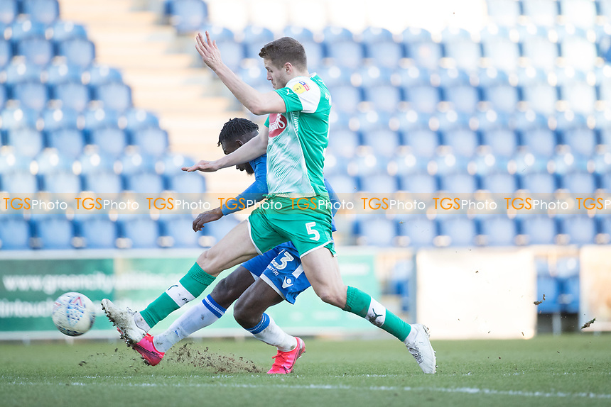 Theo Robinson of Colchester United gets a shot on target despite the attention of Scott Wootton of Plymouth Argyle during Colchester United vs Plymouth Argyle, Sky Bet EFL League 2 Football at the JobServe Community Stadium on 8th February 2020