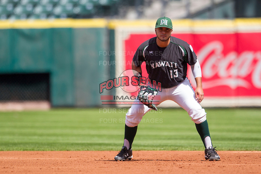 Hawaii Rainbow Warriors first baseman Eric Ramirez (13) on defense during Houston College Classic against the Baylor Bears on March 6, 2015 at Minute Maid Park in Houston, Texas. Hawaii defeated Baylor 2-1. (Andrew Woolley/Four Seam Images)