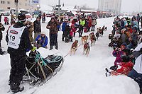 Saturday, March 3, 2012  the crowd along 4th avenue wishes Travis Cooper well during the Ceremonial Start of Iditarod 2012 in Anchorage, Alaska.