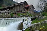 Old wooden farm building alongside fast flowing mountain stream. Gries. Sölden district, Tyrol, Tirol, Alps Austria.