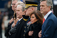 Former U.S. President George W. Bush and members of the Bush family watch as a joint services military honor guard carries the flag-draped casket of former U.S. President George H.W. Bush from the U.S. Capitol in Washington, Wednesday, Dec. 5, 2018. <br /> CAP/MPI/RS<br /> &copy;RS/MPI/Capital Pictures