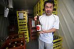 "Chief brewer Kazuhiro Ueno poses with a bottle of ""Fukko no Sake"" (Recovery Sake) at Nakayu Sake Brewery in Kami Town, Miyagi Prefecture,  Japan on 02 Sept. 2012. Photographer: Robert Gilhooly"