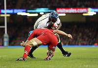 Pictured: Leone Nakarawa of Fiji is tackled by Justin Tipuric of Wales Saturday 15 November 2014<br />