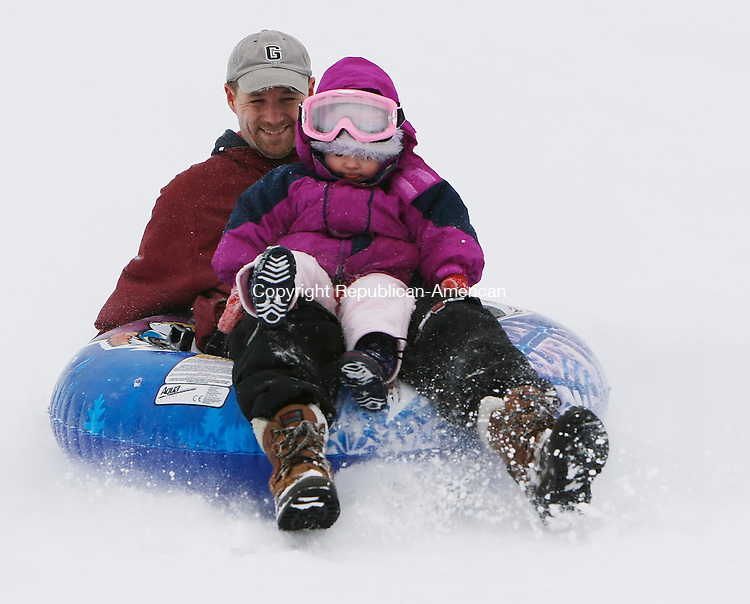 MIDDLEBURY, CT, 01/18/08- 011809BZ03- Bill Spring and his daughter Michaela, 2, of Watertown, use a tube on a hill near the Shepardson Community Center in Middlebury Sunday.<br />  Jamison C. Bazinet Republican-American