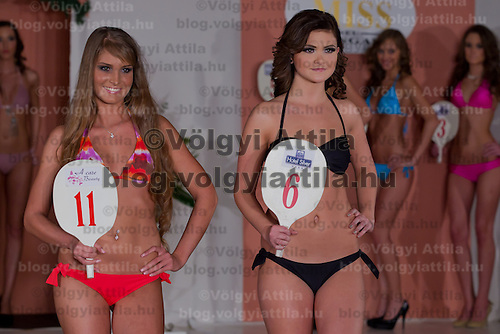 Nikolett Czibolya (L) and Kitti Csonka (R) participate the Miss Hungary beauty contest held in Budapest, Hungary on December 29, 2011. ATTILA VOLGYI