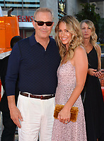 "LOS ANGELES, USA. August 02, 2019: Kevin Kostner & Christine Baumgartner at the premiere of ""The Art of Racing in the Rain"" at the El Capitan Theatre.<br /> Picture: Paul Smith/Featureflash"