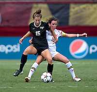 Megan Gibbons (16) of Maryland fights for the ball with Caroline Wootten (15) of Wake Forest during the game at Ludwig Field in College Park, MD.  Maryland defeated Wake Forest, 1-0.