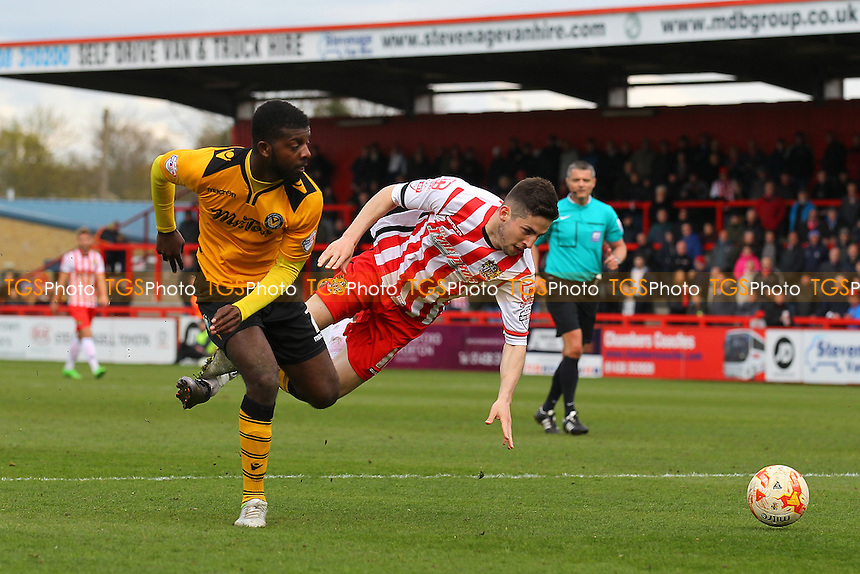 Tom Pett of Stevenage tangles with Medy Elito of Newport County during Stevenage vs Newport County, Sky Bet League 2 Football at the Lamex Stadium on 16th April 2016