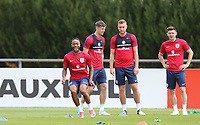 Raheem Sterling (Manchester City) of England with teammates (l-r) John Stones, Ben Gibson & Aaron Cresswell during an open England football team training session at Stade Omnisport, Croissy sur Seine, France  on 12 June 2017 ahead of England's friendly International game against France on 13 June 2017. Photo by David Horn/PRiME Media Images.