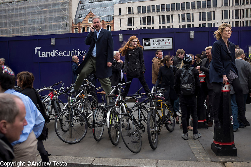 UK. London. 17th April 2013..Mourners stand on bicycles to gain a better view of Margaret Thatcher's funeral procession..©Andrew Testa/Panos