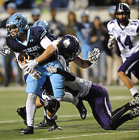 NWA Democrat-Gazette/ANDY SHUPE<br /> Fuller Chandler (8) of Har-Ber is taken down by Luke Rhoads of Fayetteville Saturday, Dec. 5, 2015, during the first half of the Class 7A state championship game at War Memorial Stadium in Little Rock. Visit nwadg.com/photos to see more photographs from the game.