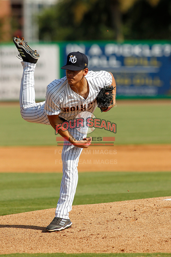 """Charleston Riverdogs pitcher Alex Mauricio (21) on the mound during a game against the Hickory Crawdads at the Joseph P. Riley Ballpark in Charleston, South Carolina. For Sunday games, the Riverdogs wear their """"Holy City"""" uniforms in honor of the city's nickname. Hickory defeated Charleston 8-7. (Robert Gurganus/Four Seam Images)"""