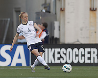 USWNT defender Becky Sauerbrunn  (4) passes the ball.  In an international friendly, the U.S. Women's National Team (USWNT) (white/blue) defeated Korea Republic (South Korea) (red/blue), 4-1, at Gillette Stadium on June 15, 2013.
