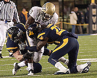 WVU's defense stops Pitt running back Dion Lewis. The West Virginia Mountaineers defeated the Pittsburgh  Panthers 19-16 on November27, 2009 at Mountaineer Field at Milan Puskar Stadium, Morgantown, West Virginia.