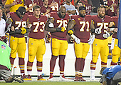 "From left to right: Washington Redskins offensive tackle Ty Nsekhe (79), center Chase Roullier (73), offensive tackle Morgan Moses (76), offensive tackle Trent Williams (71), and offensive guard Brandon Scherff (75) lock arms in solidarity as the national anthem is sung prior to the game against the Oakland Raiders at FedEx Field in Landover, Maryland on Sunday, September 24, 2017.  The Redskins chose to demonstrate prior to their nationally televised contest following tweets earlier in the day from United States President Donald J. Trump urging owners to ""fire or suspend"" players who participated in the protests by not standing for the anthem.<br /> Credit: Ron Sachs / CNP"
