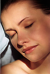 woman (early 20s) facing camera with eyes closed and serene look on face, sleeping