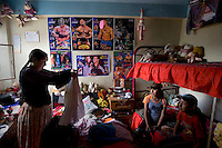29 year old wrestler Martha La Altena (fighting name), Yenny Wilma Maraz (real name) stands in her daughters' room, with posters of famous wrestlers on the wall. Yenny is a Cholita, a wrestler of native Aymara descent. When Cholitas fight they wear traditional costume. Yenny fights with the lucha libre (free wrestling) group Los Titanes del Ring. ....
