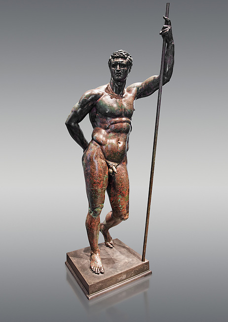 Rare Greek bronze statue known as the Hellenistic Prince, a 2nd cent BC Hellenistic bronze, one of the few in existence.  The figure is leaning with its left arm on a long shaft, a modern replica of the original bronze spear. The head clearly shows that the artist intended it as a portrait as it is proportionally smaller than the rest of the body. The letter L. VI.P.L.XXIIX, later incised on the abdomen are inventory numbers that included the statue in the catalogue of works of art present in Rome during the Republican period. Records of the catalogue (Tabulae) ere kept in the Tabulatium archives on the Capitoline Hill. The figure is represented in heroic nudity and is a copy of a famous statue by Lysippus (371-305 BC) of Alexander the Great. The statue is considered to depict a Hellenistic Prince, possibly an early portrait of Attalus II, King of Pergamon. More recent interpretations take into account the realistic facial features and consider the work to be a portrait of a Roman who had ties to the Greek world and wished to be represented as a Hellenistic Prince. This is a rare example of a 2nd cent BC Hellenistic bronze statue  The National Roman Museum, Rome, Italy