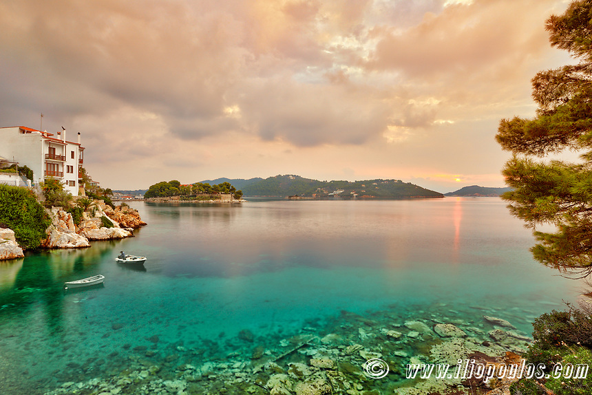 The sunrise at the old port in the Chora of Skiathos island, Greece