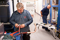 Trainee plumbers doing pipework, Able Skills training centre, Dartford, Kent.