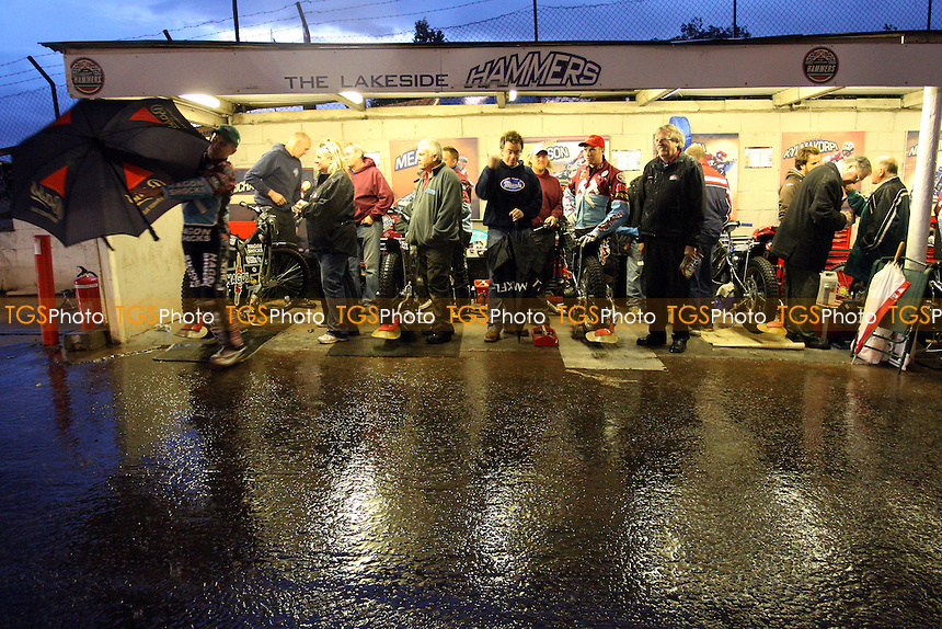 Lakeside riders and staff shelter in the pits during a torrential rainstorm after Heat 1 - Lakeside Hammers vs Ipswich Witches - Sky Sports Elite League Speedway at Arena Essex Raceway, Purfleet - 28 /08/09 - MANDATORY CREDIT: Gavin Ellis/TGSPHOTO - Self billing applies where appropriate - Tel: 0845 094 6026