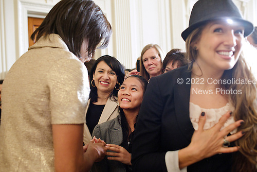 First Lady Michelle Obama greets guests during the International Women's Day reception in the East Room of the White House, March 8, 2011. .Mandatory Credit: Samantha Appleton - White House via CNP