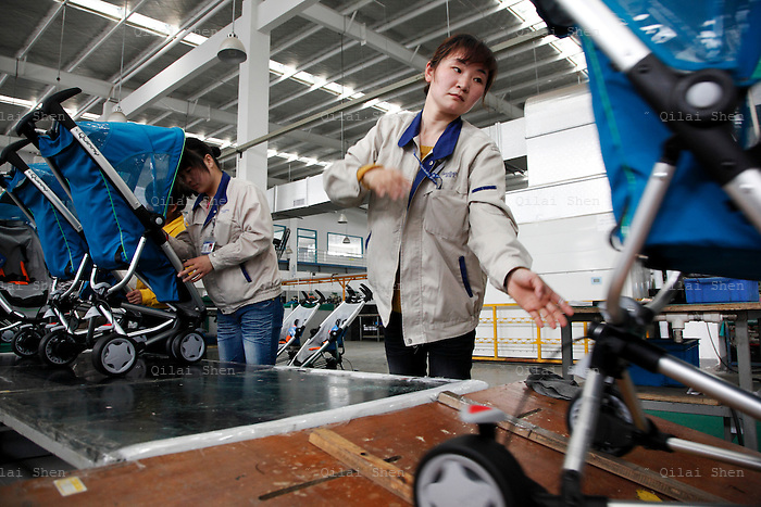 Workers assemble strollers at a Goodbaby factory in Kunshan China, on Monday, May 04, 2009. Goodbaby is China's largest manufacturer and supplier of infants' and children's products