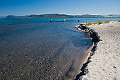 Trout fishermen fishing the Waitahunui rivermouth, Lake Taupo, Waikato, New Zealand