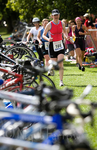 20 JUL 2008 - MANLEY, UK - Competitors race through transition during T2 - Deva Divas Triathlon. (PHOTO (C) NIGEL FARROW)