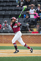 Drew Reid (5) of the Harvard Crimson follows through on his swing against the Wake Forest Demon Deacons at David F. Couch Ballpark on March 5, 2016 in Winston-Salem, North Carolina.  The Crimson defeated the Demon Deacons 6-3.  (Brian Westerholt/Four Seam Images)