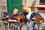 Kerry Fleadh Cheoil : Members of Ballydonoghue CCE busking in Ballybunion during the Kerry Fleah Cheoil. L - R : Alan & Tom Foley, Patrick Kissane & Paddy Foley.