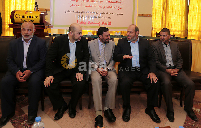 Palestinian Hamas leaders Mousa Abu Marzouk and Imad al-Alami, attend a welcome reception in Gaza city on May 28, 2015. Photo by Ramadan Al-Agha