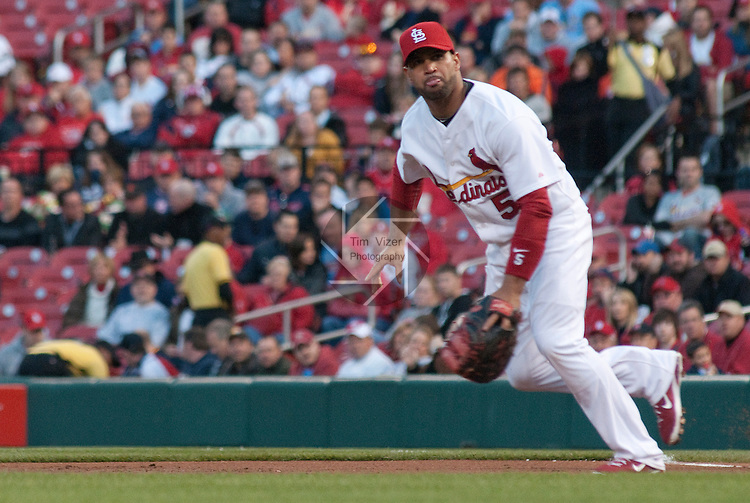 03 May 2011                              St. Louis Cardinals first baseman Albert Pujols (5) moves to cut off a bouncing ball in the top of the second inning.  He snagged the ball and threw to second base for the out on Florida Marlins first baseman Gaby Sanchez (15) who was advancing from first base on the hit. The St. Louis Cardinals hosted the Florida Marlins on Tuesday May 3, 2011 in the second game of a four-game series at Busch Stadium in downtown St. Louis.