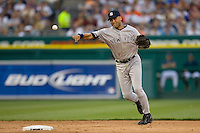 Shortstop Derek Jeter #2 of the New York Yankees makes a throw to first base against the Detroit Tigers at Comerica Park April 27, 2009 in Detroit, Michigan.  Photo by Brian Westerholt / Four Seam Images