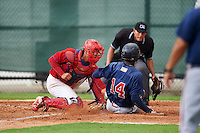 GCL Phillies catcher Nerluis Martinez (11) tags out Jeremy Fernandez (14) sliding into home as umpire Kelvis Velez looks on to make the call during a game against the GCL Braves on August 3, 2016 at the Carpenter Complex in Clearwater, Florida.  GCL Phillies defeated GCL Braves 4-3 in a rain shortened six inning game.  (Mike Janes/Four Seam Images)