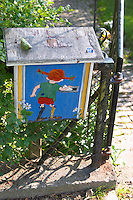 A letter box painted with Pippi Longstocking posting a letter. Vimmerby town Smaland region. Sweden, Europe.