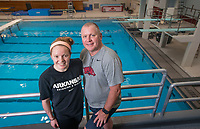 Hawgs Illustrated/BEN GOFF <br /> Brooke Schultz, a freshman diver from Fayetteville, and father Dale Schultz, who is also the Arkansas diving coach, pose for a photo Wednesday, Oct. 4, 2017 at the HPER building in Fayetteville.